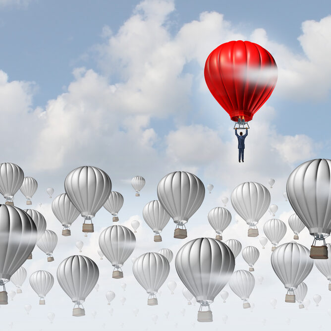 The best leadership concept with a group of grey hot air balloons in the sky and a red aircraft guided by a business leader rising above the competition as a success metaphor for leadership.